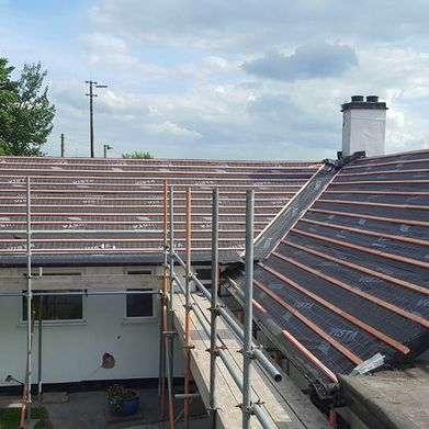 View of the progress of a new roof for a residential home