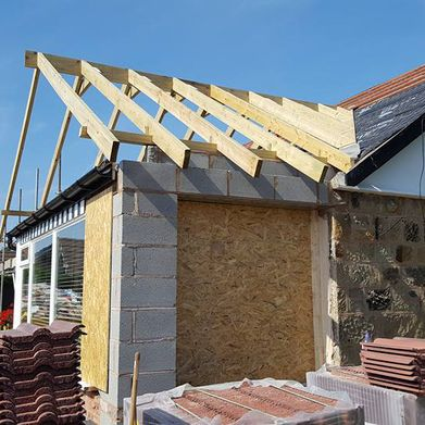A new roof being added to an home extension
