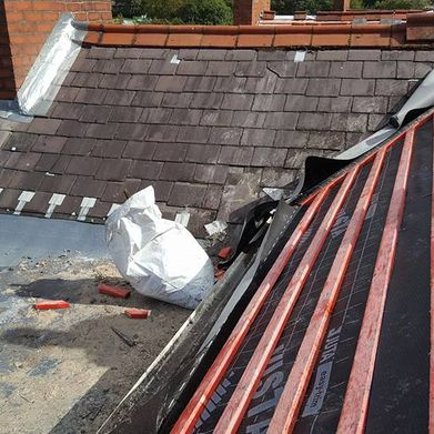 our team completing a re-roofing task