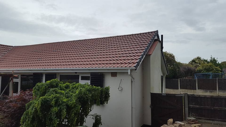 Side view of completed roofing work by our team