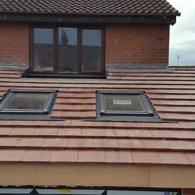 View of a small roof with veluxes installed by our team