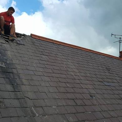A newly started re-roofing job
